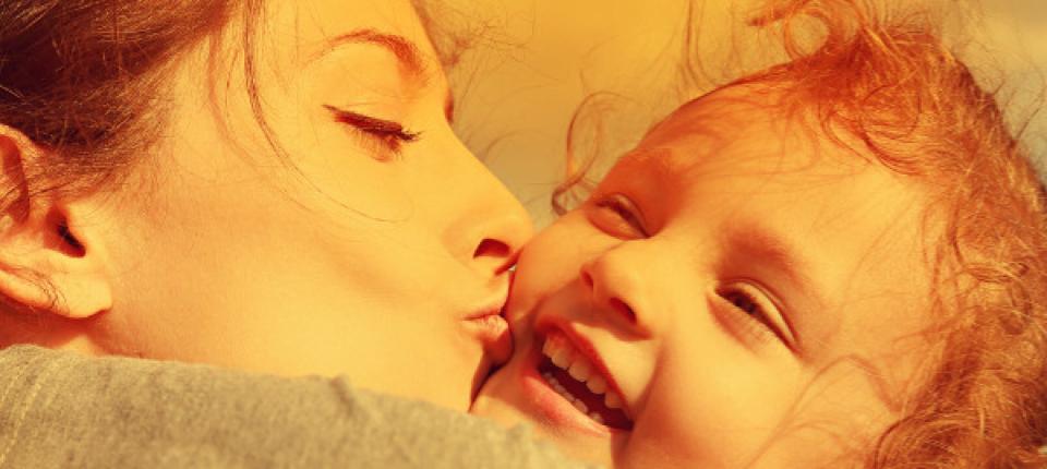 mom-kissing-daughter
